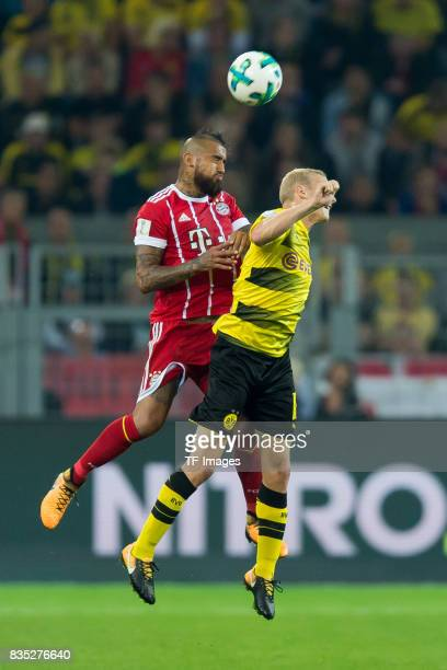 Arturo Vidal of Bayern Muenchen and Sebastian Rode of Dortmund battle for the ball during the DFL Supercup 2017 match between Borussia Dortmund and...