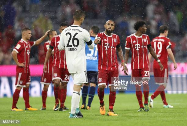 Arturo Vidal of Bayern Muenchen and Sven Ulreich of Bayern Muenchen celebrate after the Bundesliga match between FC Bayern Muenchen and Bayer 04...