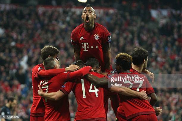 Arturo Vidal of Bayern Muenchen and teammates celebrate their first goal during the Champions League semi final second leg match between FC Bayern...