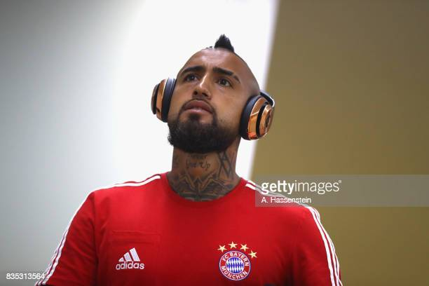 Arturo Vidal of Bayern Muenchen arrives for the Bundesliga match between FC Bayern Muenchen and Bayer 04 Leverkusen at Allianz Arena on August 18...