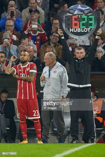 Arturo Vidal of Bayern Muenchen Assistent coach Hermann Gerland of Bayern Muenchen and Referee Maksim Gavrilin looks on during the UEFA Champions...