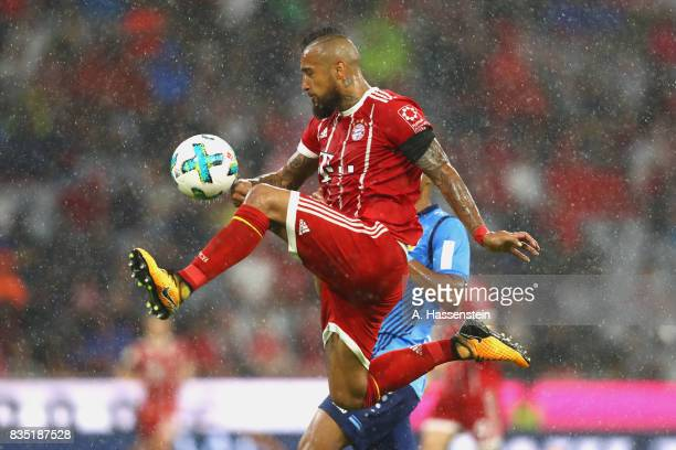 Arturo Vidal of Bayern Muenchen battles for the ball during the Bundesliga match between FC Bayern Muenchen and Bayer 04 Leverkusen at Allianz Arena...