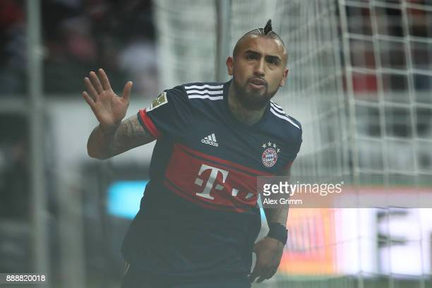 Arturo Vidal of Bayern Muenchen celebrates after he scored a goal to make it 10 during the Bundesliga match between Eintracht Frankfurt and FC Bayern...