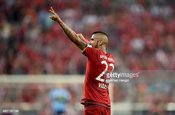 Arturo Vidal of Bayern Muenchen celebrates after the Bundesliga match between FC Bayern Muenchen and Bayer Leverkusen at Allianz Arena on August 29...