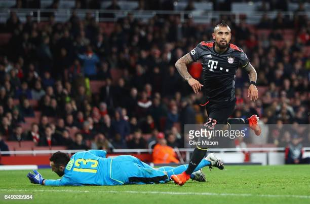 Arturo Vidal of Bayern Muenchen celebrates as he scores their fifth goal as David Ospina of Arsenal looks dejected during the UEFA Champions League...