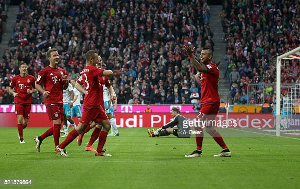 Arturo Vidal of Bayern Muenchen celebrates his goal with teammates and goalkeeper Ralf Faehrmann of Schalke reacts during the Bundesliga match...