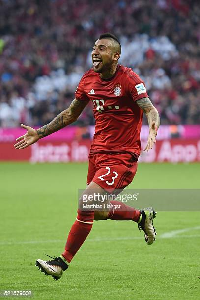 Arturo Vidal of Bayern Muenchen celebrates scoring his sides third goal during the Bundesliga match between FC Bayern Muenchen and FC Schalke 04 at...
