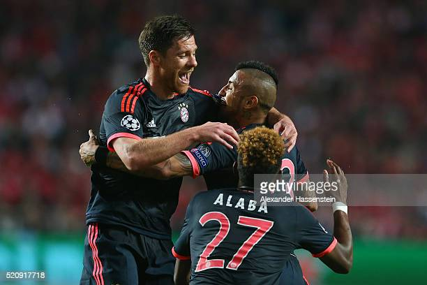 Arturo Vidal of Bayern Muenchen celebrates scoring his team's opening goal with Xabi Alonso during the UEFA Champions League quarter final second leg...
