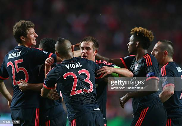 Arturo Vidal of Bayern Muenchen celebrates scoring his team's opening goal with Philipp Lahm during the UEFA Champions League quarter final second...