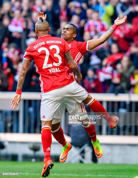 Arturo Vidal of Bayern Muenchen celebrates the first goal for his team with Douglas Costa of Bayern Muenchen during the Bundesliga match between...