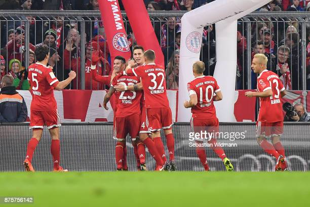 Arturo Vidal of Bayern Muenchen celebrates with his team after he scored a goal to make it 10 during the Bundesliga match between FC Bayern Muenchen...