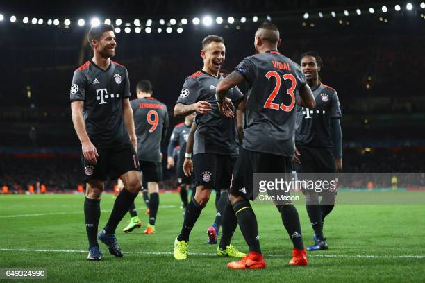 Arturo Vidal of Bayern Muenchen celebrates with Rafinha and team mates as he scores their fourth goal during the UEFA Champions League Round of 16...