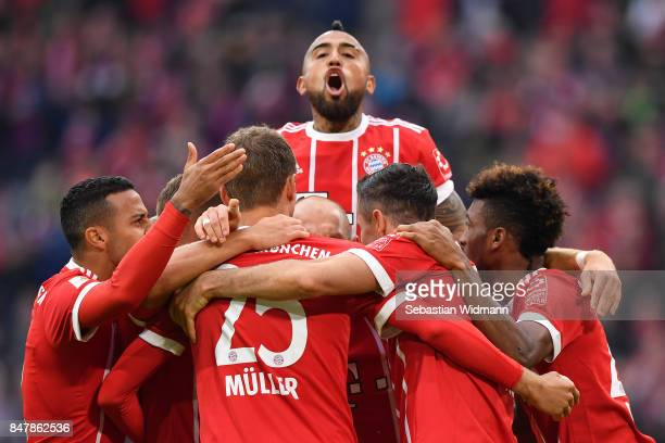 Arturo Vidal of Bayern Muenchen celebrates with team makes after Robert Lewandowski of Bayern Muenchen scored his teams third goal to make it 30...