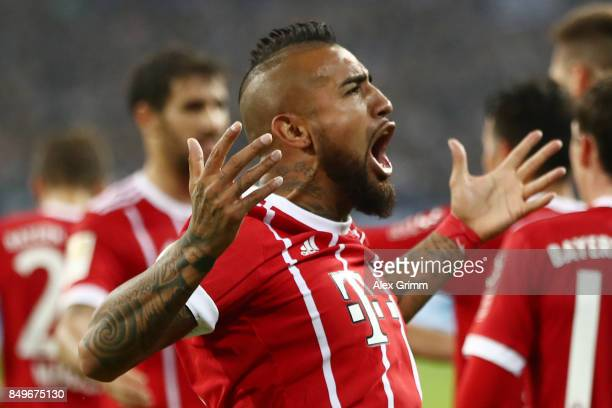 Arturo Vidal of Bayern Muenchen celebrates with team mates after he scored his teams third goal to make it 30 during the Bundesliga match between FC...