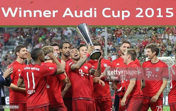 Arturo Vidal of Bayern Muenchen celebrates with teammates the victory of the Audi Cup final match between FC Bayern Muenchen and Real Madrid at...