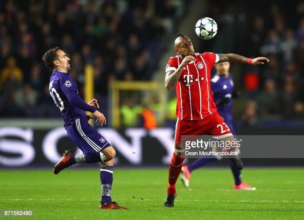 Arturo Vidal of Bayern Muenchen is challenged by Sven Kums of RSC Anderlecht during the UEFA Champions League group B match between RSC Anderlecht...