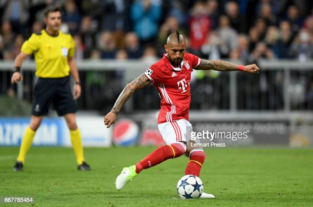 Arturo Vidal of Bayern Muenchen misses a penalty during the UEFA Champions League Quarter Final first leg match between FC Bayern Muenchen and Real...