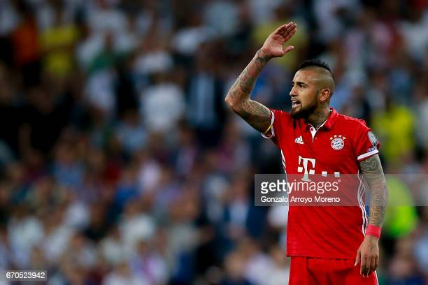 Arturo Vidal of Bayern Muenchen protests after being expelled during the UEFA Champions League Quarter Final second leg match between Real Madrid CF...