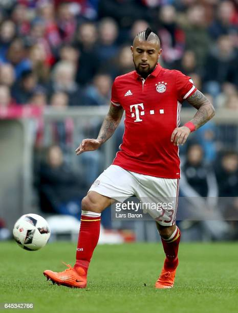 Arturo Vidal of Bayern Muenchen runs with the ball during the Bundesliga match between Bayern Muenchen and Hamburger SV at Allianz Arena on February...