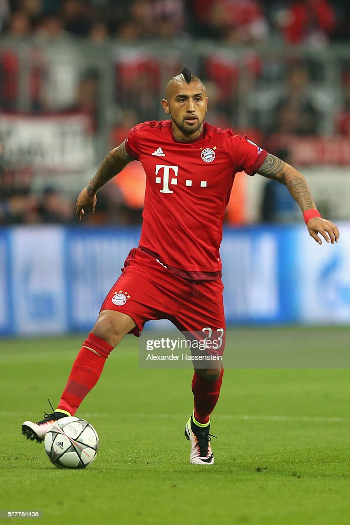 <a gi-track='captionPersonalityLinkClicked' href=/galleries/search?phrase=Arturo+Vidal&family=editorial&specificpeople=2223374 ng-click='$event.stopPropagation()'>Arturo Vidal</a> of Bayern Muenchen runs with the ball during the UEFA Champions League semi final second leg match between FC Bayern Muenchen and Club Atletico de Madrid at Allianz Arena on May 3, 2016 in Munich, Germany.