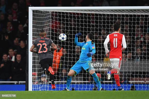 Arturo Vidal of Bayern Muenchen scores their fourth goal past David Ospina of Arsenal during the UEFA Champions League Round of 16 second leg match...