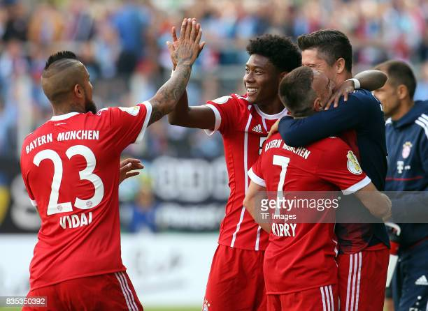 Arturo Vidal of Bayern Muenchen shakes hands with David Alaba of Bayern Muenchen during the DFB Cup first round match between Chemnitzer FC and FC...