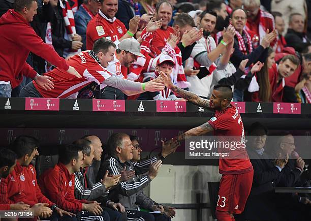 Arturo Vidal of Bayern Muenchen shakes hands with supportes after leaving the pitch during the Bundesliga match between FC Bayern Muenchen and FC...