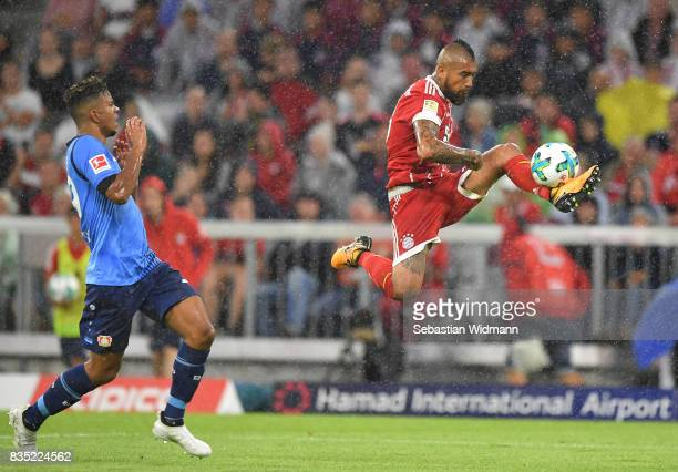 Arturo Vidal of Bayern Muenchen with Benjamin Henrichs of Bayer Leverkusen during the Bundesliga match between FC Bayern Muenchen and Bayer 04...