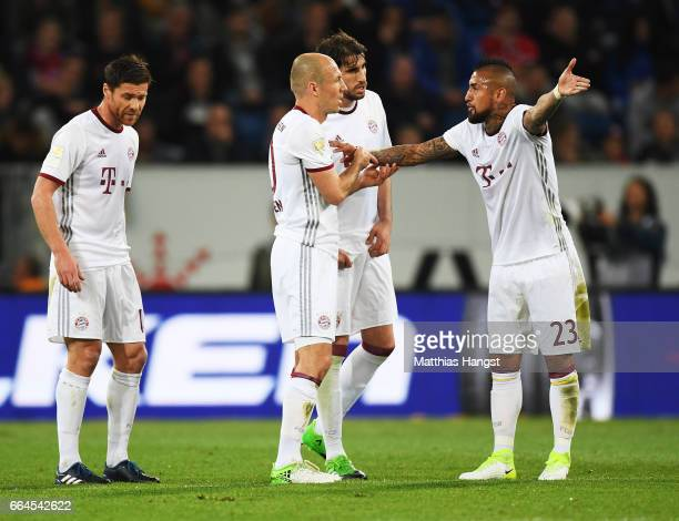 Arturo Vidal of Bayern Munich and Arjen Robben have a discussion after Andrej Kramaric of 1899 Hoffenheim scored a goal during the Bundesliga match...