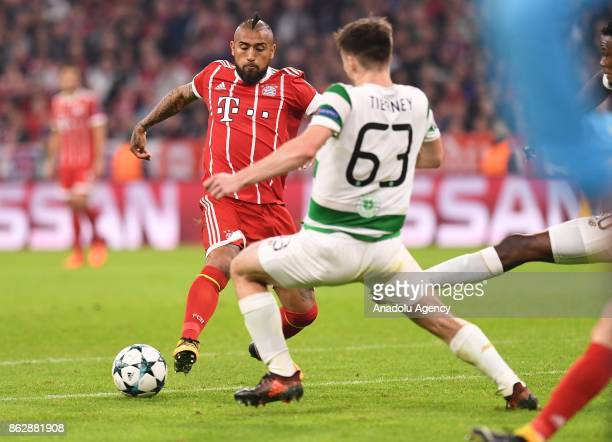 Arturo Vidal of Bayern Munich and Kieran Tierney of Celtic vie for the ball during the UEFA the Champions League group B soccer match between FC...