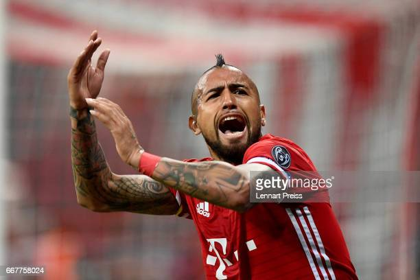 Arturo Vidal of Bayern Munich celebrates after scoring the opening goal during the UEFA Champions League Quarter Final first leg match between FC...