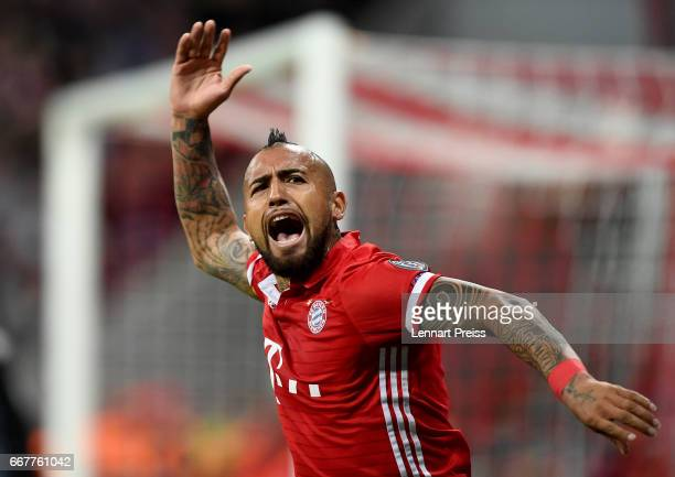 Arturo Vidal of Bayern Munich celebrates after scoring the opening goal during the UEFA Champions League Quarter Final first leg match between FC...