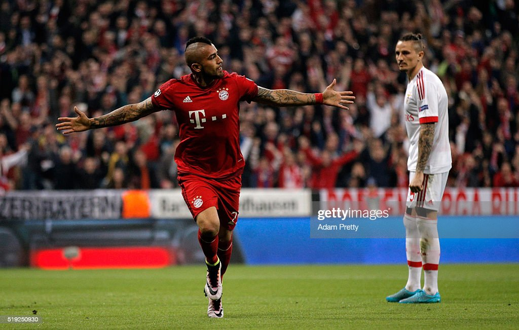 Arturo Vidal of Bayern Munich celebrates as he scores their first goal during the UEFA Champions League quarter final first leg match between FC...