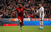 Arturo Vidal of Bayern Munich celebrates as he scores their first goal during the UEFA Champions League quarter final first leg match between FC...