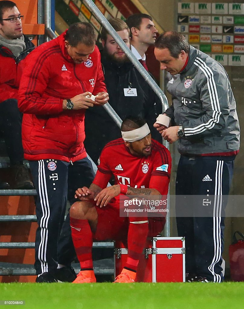 <a gi-track='captionPersonalityLinkClicked' href=/galleries/search?phrase=Arturo+Vidal&family=editorial&specificpeople=2223374 ng-click='$event.stopPropagation()'>Arturo Vidal</a> of Bayern Munich is given treatment for a head injury during the Bundesliga match between FC Augsburg and FC Bayern Muenchen at SGL Arena on February 14, 2016 in Augsburg, Germany.