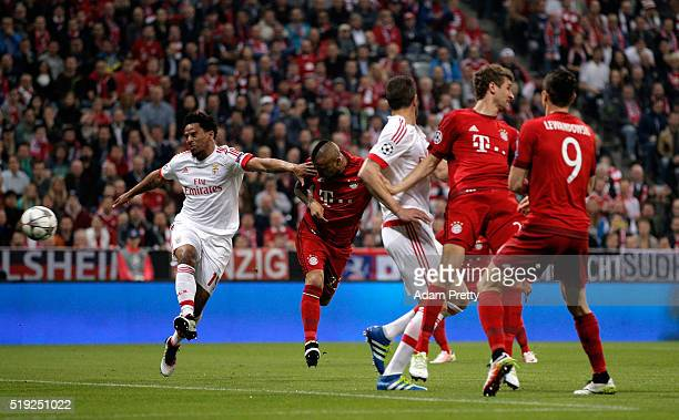 Arturo Vidal of Bayern Munich scores their first goal during the UEFA Champions League quarter final first leg match between FC Bayern Muenchen and...