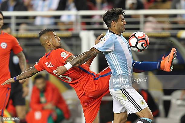 Arturo Vidal of Chile and Augusto Fernandez of Argentina fight for the ball during a group D match between Argentina and Chile at Levi's Stadium as...