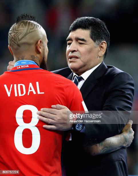Arturo Vidal of Chile and Diego Maradona embrace after the FIFA Confederations Cup Russia 2017 Final between Chile and Germany at Saint Petersburg...