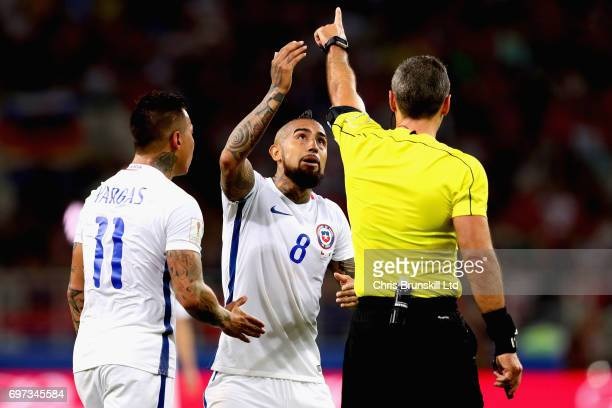 Arturo Vidal of Chile and Eduardo Vargas of Chile appeal to referee Damir Skomina after he disallowed a goal for Chile using the video referee during...