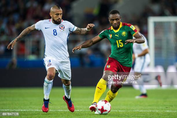 Arturo Vidal of Chile and Sebastien Siani of Cameroon fight for the ball during the FIFA Confederations Cup Russia 2017 Group B match between...