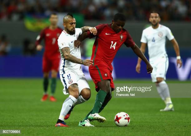 Arturo Vidal of Chile and William Carvalho of Portugal battle for possession during the FIFA Confederations Cup Russia 2017 SemiFinal between...