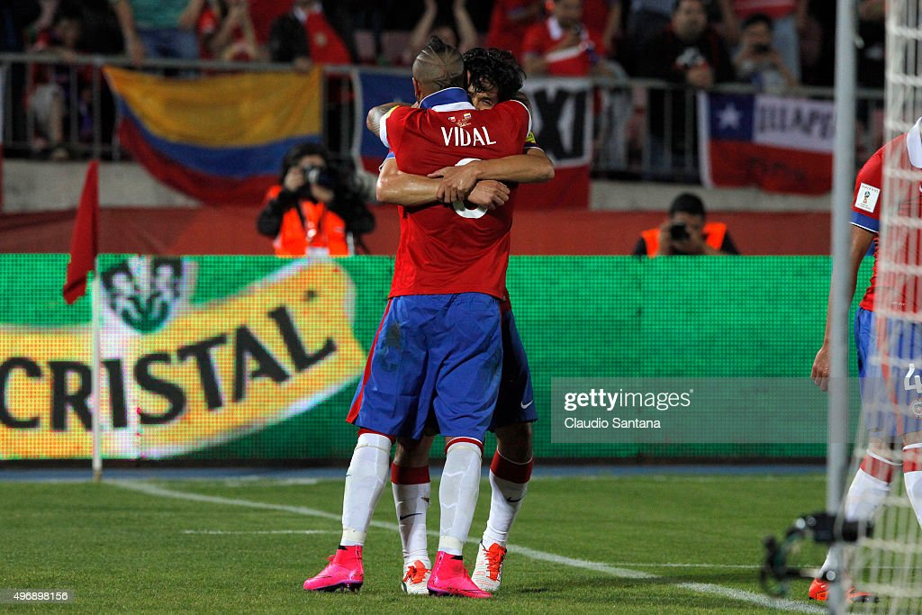 Arturo Vidal of Chile calebrates with Matias Fernandez after scoring the opening goal during a match between Chile and Colombia as part of FIFA 2018...