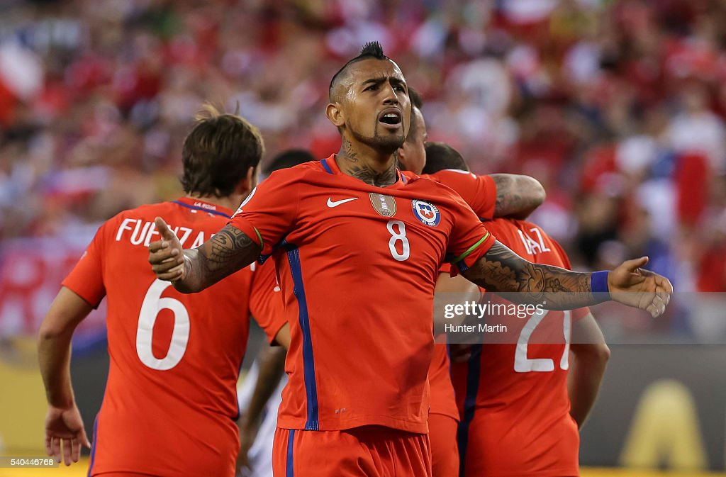 <a gi-track='captionPersonalityLinkClicked' href=/galleries/search?phrase=Arturo+Vidal&family=editorial&specificpeople=2223374 ng-click='$event.stopPropagation()'>Arturo Vidal</a> of Chile celebrates after a goal scored by his teammate Eduardo Vargas (not in frame) during a group D match between Chile and Panama at Lincoln Financial Field as part of Copa America Centenario US 2016 on June 14, 2016 in Philadelphia, Pennsylvania, US.