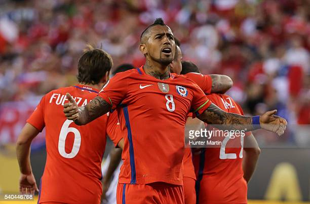 Arturo Vidal of Chile celebrates after a goal scored by his teammate Eduardo Vargas during a group D match between Chile and Panama at Lincoln...