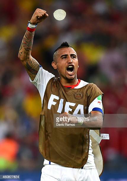 Arturo Vidal of Chile celebrates after defeating Spain 20 during the 2014 FIFA World Cup Brazil Group B match between Spain and Chile at Maracana on...