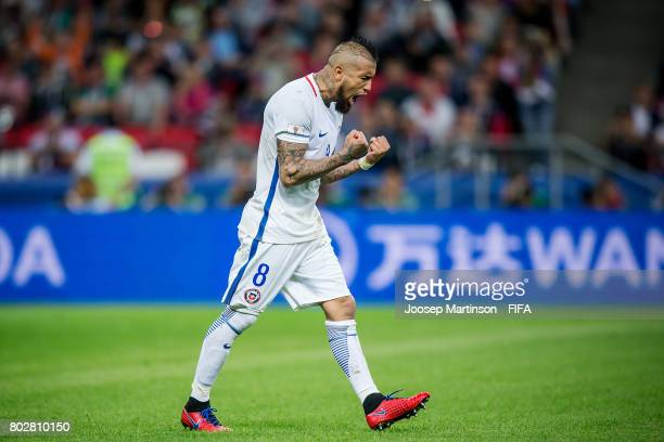 Arturo Vidal of Chile celebrates after scoring a penalty kick in the penalty shootout during FIFA Confederations Cup Russia semifinal match between...