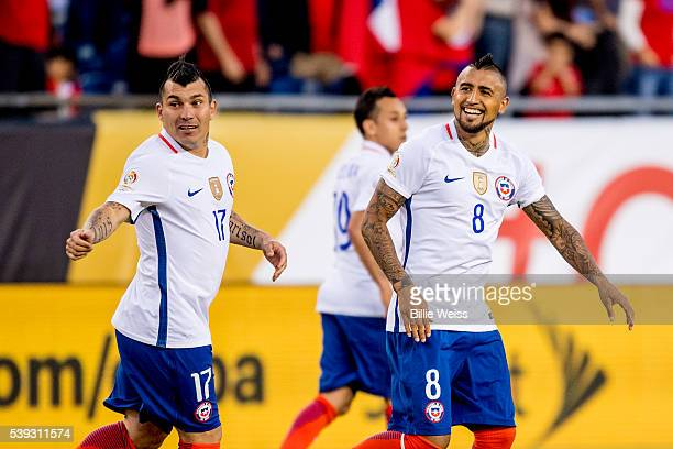 Arturo Vidal of Chile celebrates after scoring the first goal of his team during a group D match between Chile and Bolivia at Gillette Stadium as...