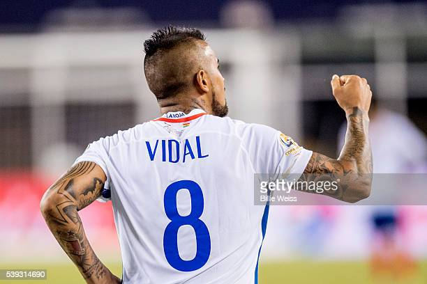 Arturo Vidal of Chile celebrates after scoring the second goal of his team through a penalty kick during a group D match between Chile and Bolivia at...