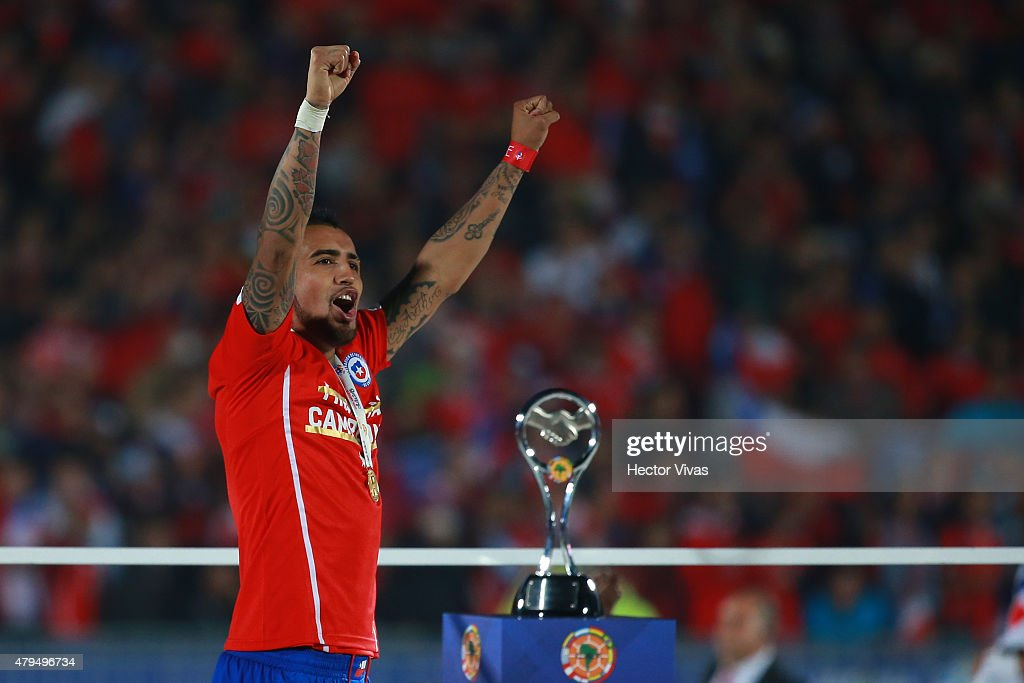 <a gi-track='captionPersonalityLinkClicked' href=/galleries/search?phrase=Arturo+Vidal&family=editorial&specificpeople=2223374 ng-click='$event.stopPropagation()'>Arturo Vidal</a> of Chile celebrates after winning the 2015 Copa America Chile Final match between Chile and Argentina at Nacional Stadium on July 04, 2015 in Santiago, Chile.