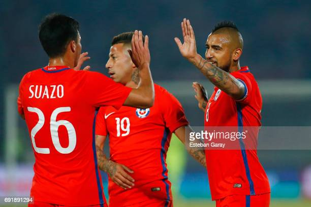Arturo Vidal of Chile celebrates with teamamte Gabriel Suazo after scoring the second goal of his team during a match between Chile and Burkina Faso...